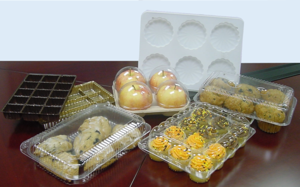 Array of thermoform packaging containing fruits and pastries